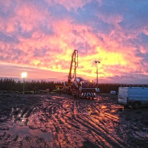 Early concrete pour at sunrise